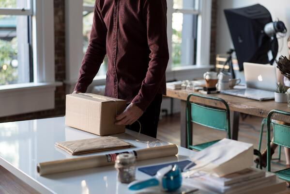 small business owner packing a box
